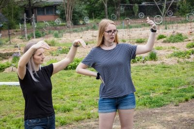 Sarah Gould (left) and Laura Gray visualize a hydroponic green house for local non-profit Tricycle Farms;