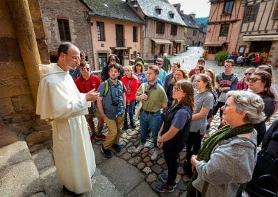 Brother Cyrille addresses the group; the Abbey Church of St. Foy, Conques.