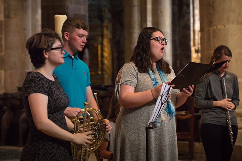 Kimmarie Counts, Jacob Purifoy, Susan Tucker and Chelsea Hodge perform after the blessing of the pilgrims at the church in Conques