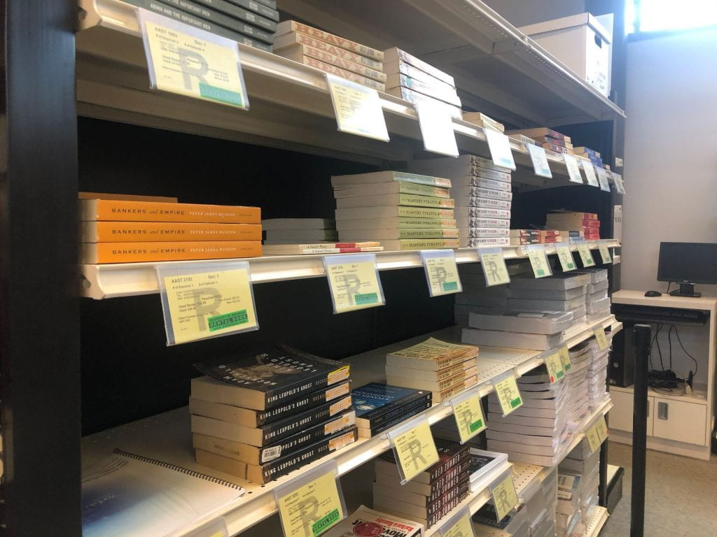 Multiple books on the shelves in the UA Bookstore