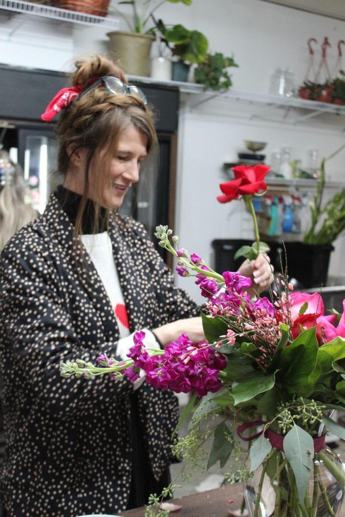 Cindy Stevenson working at ZuZu's Petals.