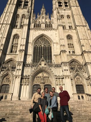 Department of Education Reform faculty members and students pose in front of a cathedral in Brussels at a previous Association for Public Policy Analysis and Management international meeting.
