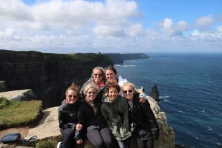 Students enjoy a sightseeing visit while on a study abroad trip to Ireland.