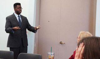 Malachi Nichols presents data at the charassein conference.