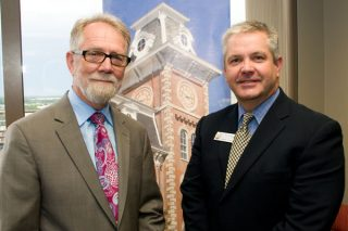 Tom Smith, left, dean of the College of Education and Health Professions, is pictured with Tom Kimbrell, Arkansas commissioner of education, at a reception announcing the first cohort of Arkansas Teacher Corps fellows. Photo by Kelly Quinn
