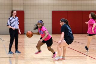 Students engage in a game of basketball at the Health, Physical Education and Recreation Building.