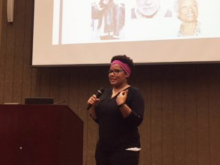 Kendra Shoge speaks about her research into racial microaggressions to students and parents at ABC Adolescent Center in Little Rock.