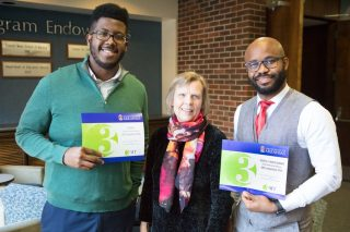 Patricia Koski, associate dean for the Graduate School and International Education (center), presents Malachi Nicholas (left) and Edidiong Udofia with their Three Minute Thesis award certificates.