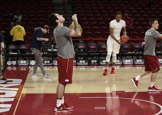 Blake Rudolph rebounds balls during Razorback basketball practice.