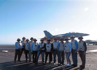 Paul Calleja is third from the left pictured on the carrier John C. Stennis with the Navy's Embark program.