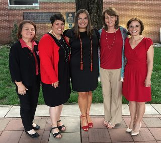 Grace Davis, center, is flanked by instructor Cathy Hale, from left, her mentor; Elizabeth McKinley, nursing academic coordinator; Allison Scott, assistant professor of nursing; and Kate Mamiseishvili, associate dean for academic and student affairs.