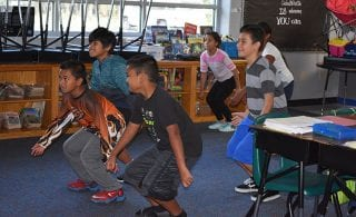 Doing a few dance moves gets students ready to learn.