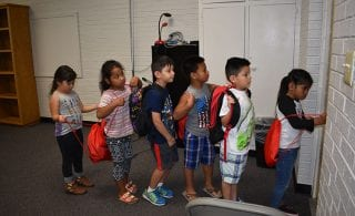 Students learn the routines of school.