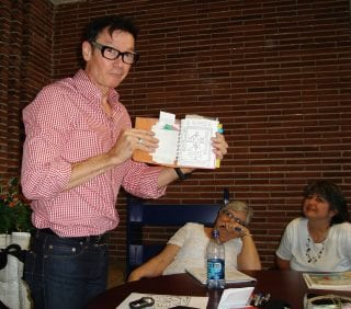 Author Jack Gantos shows his notebook filled with story ideas to a group of Northwest Arkansas teachers during a previous visit to Fayetteville.