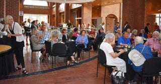 OLLI members and guests enjoy refreshments and speakers during last year's open house.