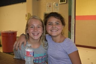 Chloe, left, and Kaybrina enjoy their time as peer mentors at Camp Connect