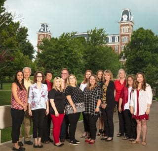 The OASIS team, from left, Ana Barker, Doug Talbott, Erica Langley, Elizabeth McKinley, Madelyn Jones, Matthew Fey, Stephanie Gragg, Julia Smith, Katie Winkler, Bailey Younger, Cindy Folsom, Deb Henderson, Denise Bignar and Laura Tilley.