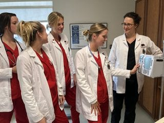 Nursing students in this semester's obstetrics clinical rotation with Brennan Straka, far right, include, from left, Emily Feierabend, Gretchen Schloegel, Amanda Kosieja and Katherine Davidson.