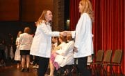 Lori Murray, assistant director for undergraduate studies, congratulates a student.