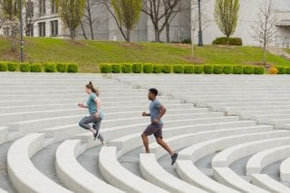 People exercise at the Chi Omega Greek Theatre.