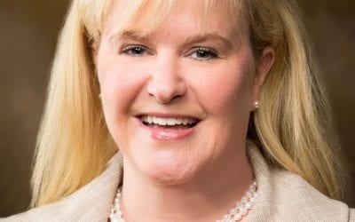 Business Magazine Profiles College Development Director