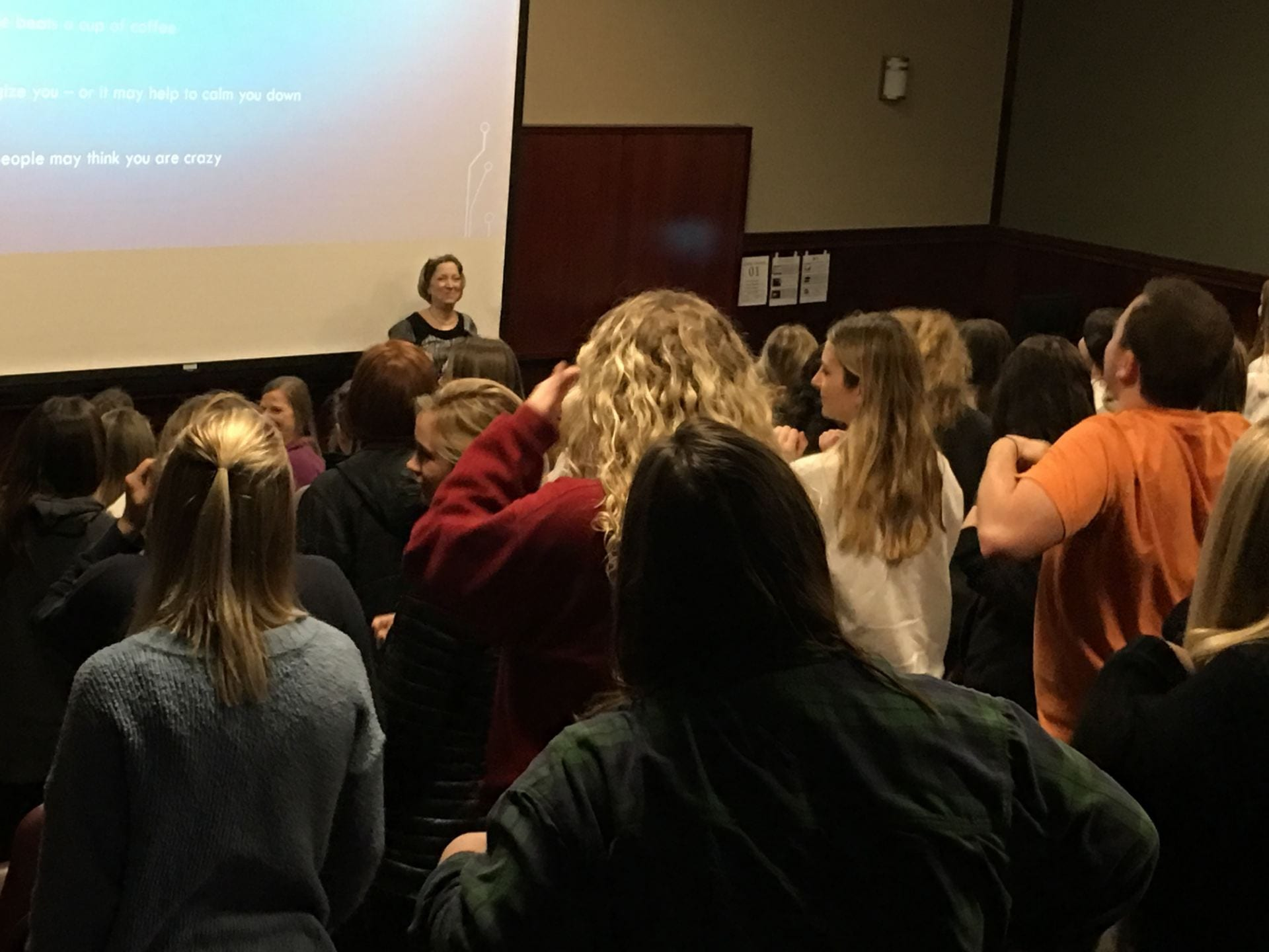 Nursing instructor Jane Hentzen leads new students in a stress-reducing stretch.