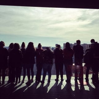 Visiting eighth-grade students look out over the University of Arkansas campus.