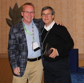 Dean Miller (right) accepts award