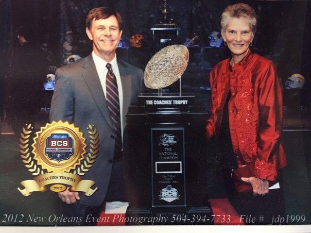 Sharon Hunt and husband, BCS National Football Championship trophy