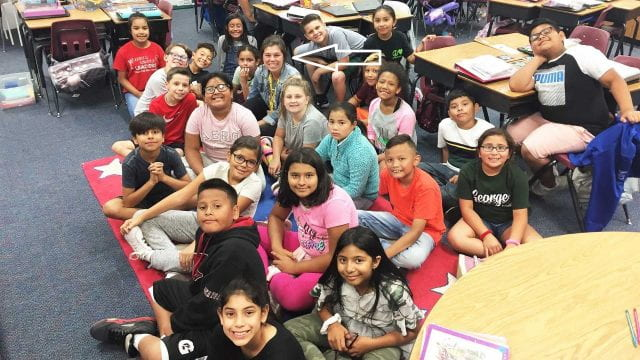 Where's Claire? Look for the arrow! She's at home among these great students at George Elementary in Springdale, Arkansas.