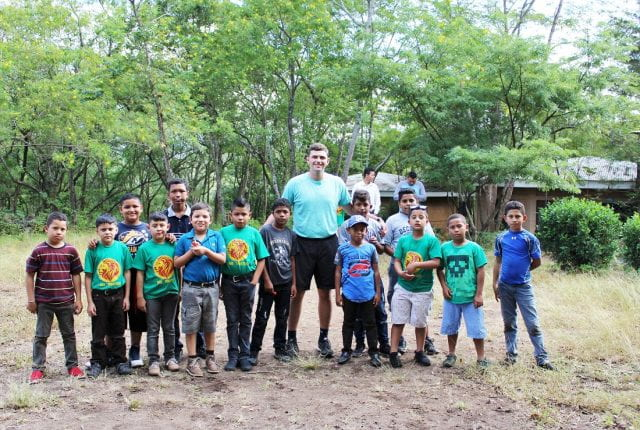 Jake Smith with 1and1 Ministries children