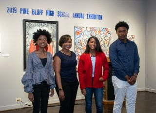 Shalisha, second from left, with students at an Arts and Science Center for Southeast Arkansas exhibit in 2019.