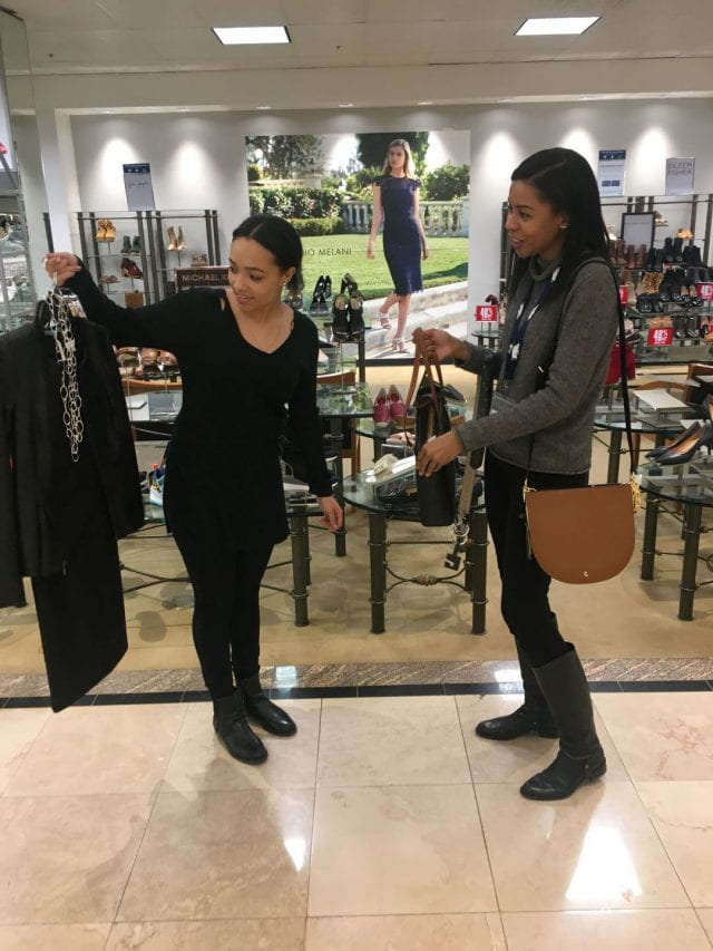 """Erin Durrah styling a student model in preparation for the """"Dress Like You Want to Be Addressed"""" CDC event"""