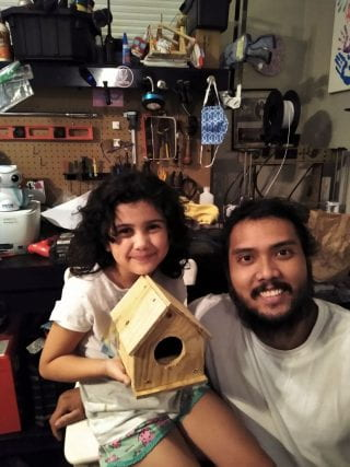 Byron Dejarlo, building birdhouses with youngest daughter