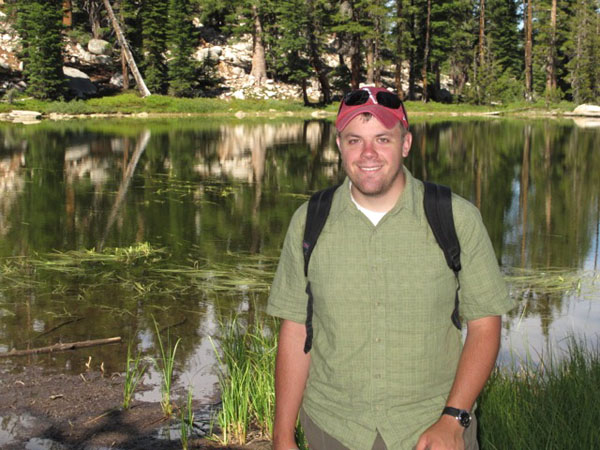 Benjamin Stinnett (B.L.A. '12) is shown in summer 2012 during a short weekend excursion to Clouds Rest, a 9,930-foot elevation mountain just east of the Yosemite Valley. The small glacial lake behind him was located along the trail.