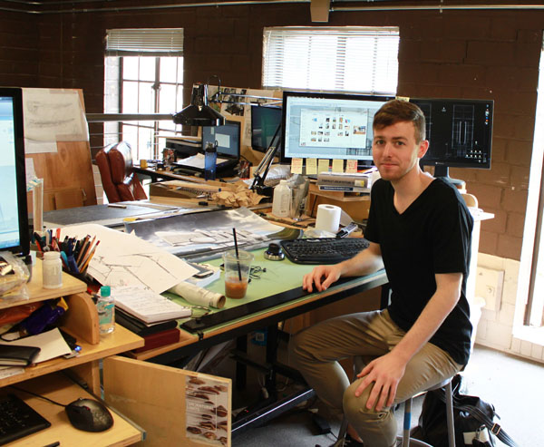 Architecture student Brady Duncan sits at his desk in the Field House.