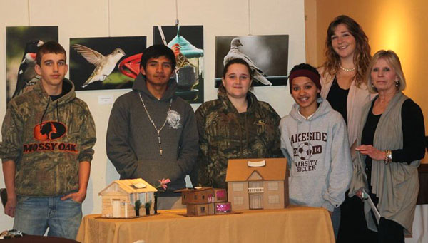 From right, Dede Gibson, executive director of Guachoya Cultural Art Center, and Alyssa Bodine, Lakeside High School art teacher, stand with the high school students who participated in Art in Architecture next to a table showing the students' models. (Photo by Charles Giles)
