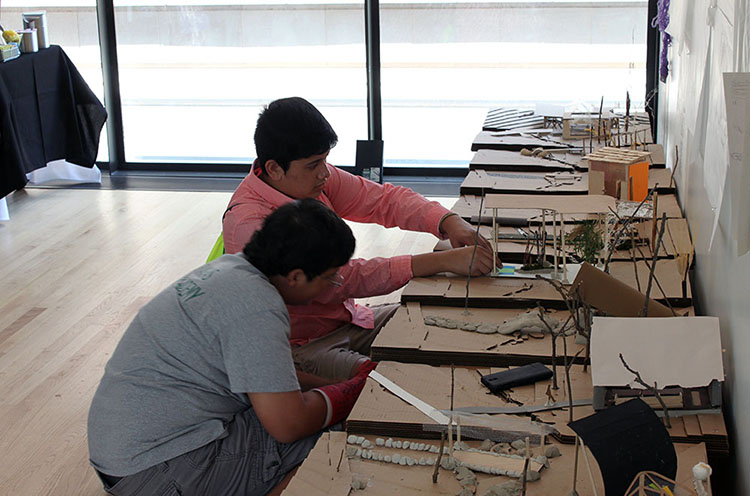 Students set up their models for the final exhibition at the closing reception. (Photo by Julia Trupp)