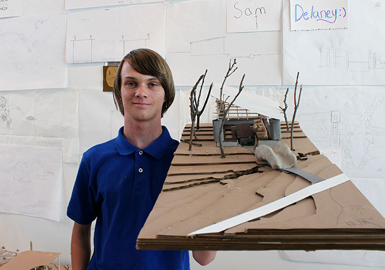 Kian McWilliams, a sophomore at Farmington High School, shows off his finished project model. (Photo by Julia Trupp)