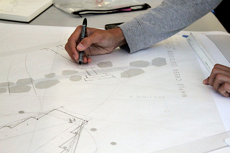 A student works on a project drawing. (Photo by Julia Trupp)