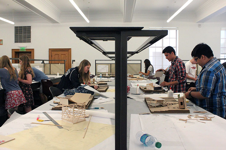 Students work on their projects in studio in Vol Walker Hall on the University of Arkansas campus in Fayetteville. (Photo by Julia Trupp)
