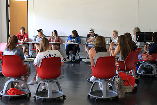 A panel of Fay Jones School students answers questions and visits with incoming freshmen and their parents in a summer orientation session.