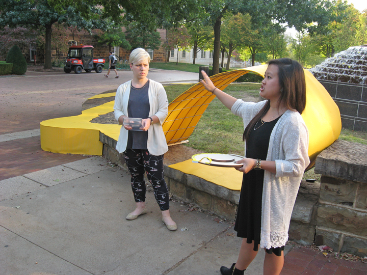 Jasmine Jetton and Jessica Phan presented their large-scale installation project exploring threshold Oct. 12. They hoped to entice the busy students walking by to sit and relax and interact with the peace fountain area. (Photo by Mattie Bailey)