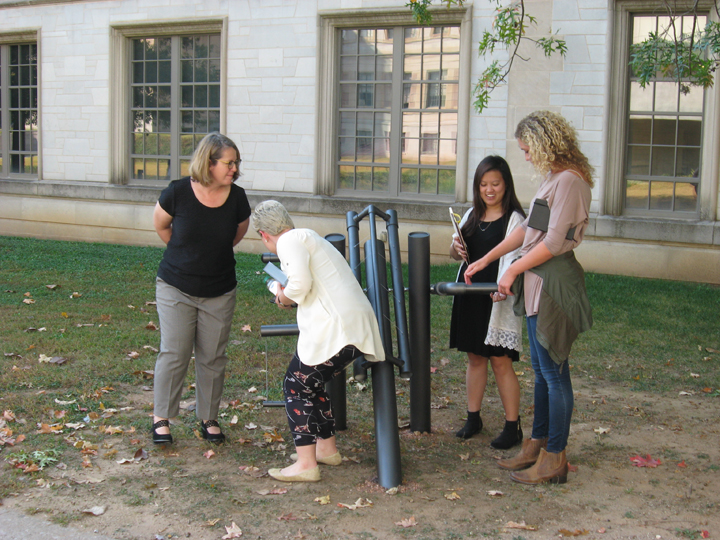 Jennifer Webb, associate professor of interior design, and students Jasmine Jetton, Jessica Phan and Emma Lambeth examine the second part of Kelsey Fenton and Elisha Taldo's project. (Photo by Mattie Bailey)