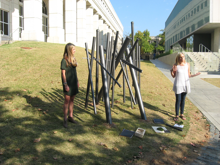 Elisha Taldo and Kelsey Fenton present their project addressing thresholds Oct. 12. (Photo by Mattie Bailey)