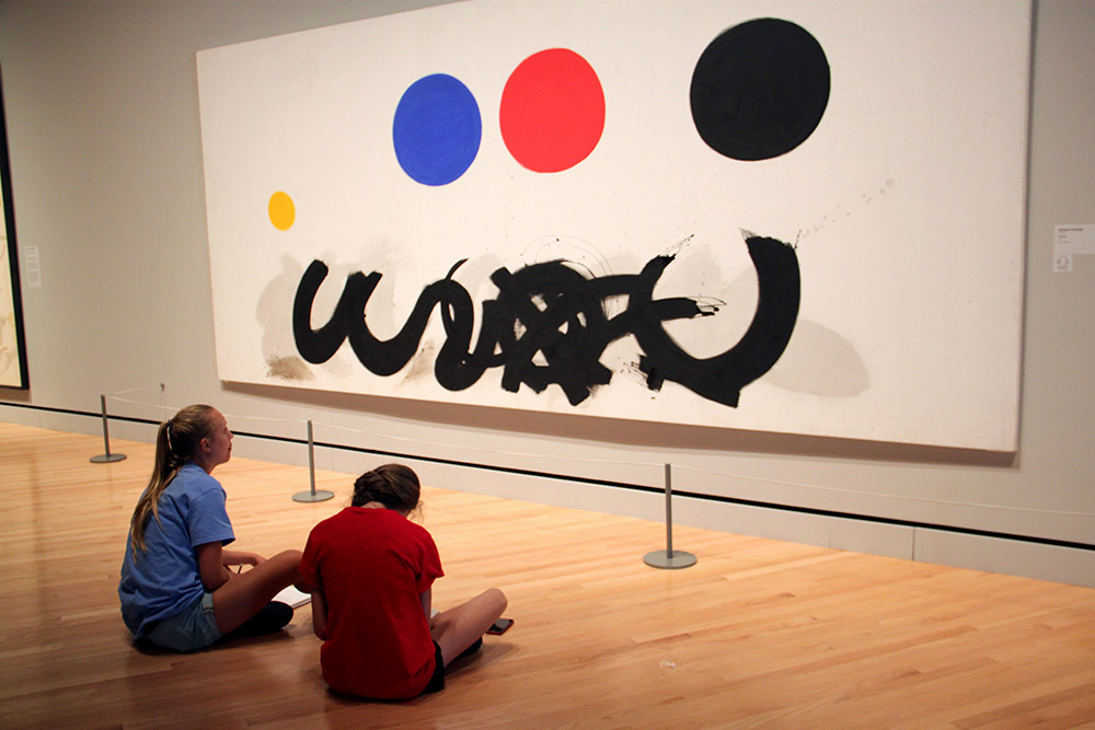 Students create gestural sketches inside one of the galleries of Crystal Bridges Museum of American Art in Bentonville.