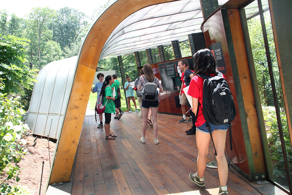 Students visit the Welcome Pavilion to the Bachman-Wilson House, designed by Frank Lloyd Wright. Fay Jones School students designed and built the pavilion for Crystal Bridges.