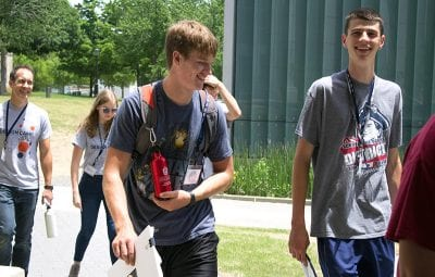 Jack Carswell walks to an activity with fellow Design Camp students.
