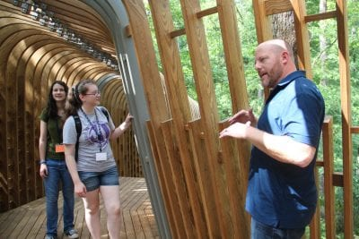 Josh Siebert, principal at Modus Studio, gives the Design Camp students a tour of the new tree house that was design by his firm.