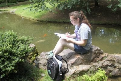 Student Keilah Barney sketches in the Garden of the Pine Wind at Garvan Woodland Gardens.